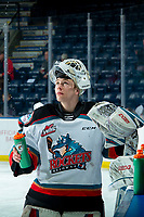 KELOWNA, BC - JANUARY 24: Cole Schwebius #31 of the Kelowna Rockets stands at the bench during warm up against the Seattle Thunderbirds at Prospera Place on January 24, 2020 in Kelowna, Canada. (Photo by Marissa Baecker/Shoot the Breeze)