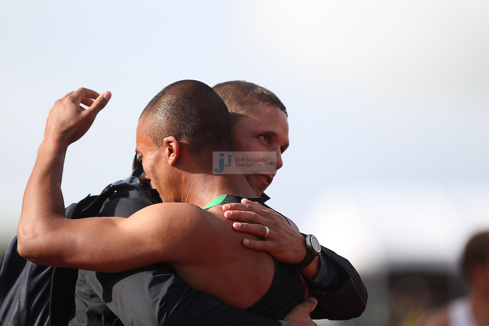 Ashton Eaton celebrates with Dan O'Brien after finishing the 1500m portion of the Decathlon for a world record during day 2 of the U.S. Olympic Trials for Track & Field at Hayward Field in Eugene, Oregon, USA 23 Jun 2012..(Jed Jacobsohn/for The New York Times)...