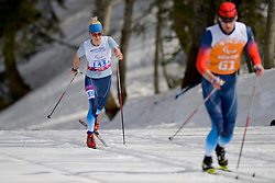 LYSOVA Mikhalina Guide: IVANOV Alexey competing in the Nordic Skiing XC Long Distance at the 2014 Sochi Winter Paralympic Games, Russia