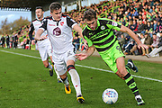 Forest Green Rovers Christian Doidge(9) runs past Morecambe's Aaron McGowan(2) during the EFL Sky Bet League 2 match between Forest Green Rovers and Morecambe at the New Lawn, Forest Green, United Kingdom on 28 October 2017. Photo by Shane Healey.