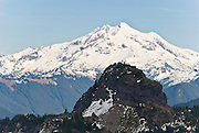 View Glacier Peak from Mount Dickerman (Trail #710) in Mount  Baker-Snoqualmie National Forest, accessible from the Mountain Loop Highway east of Verlot, Washington, USA. Glacier Peak, which rises to an elevation of 10,541 feet in Glacier Peak Wilderness, is the most isolated of the five major stratovolcanoes (composite volcanoes) of the Cascade Volcanic Arc in Washington. Glacier Peak formed during the Pleistocene epoch (about 1 million years ago) and is one of the most active of Washington's volcanoes, erupting explosively five times in the past 3,000 years.