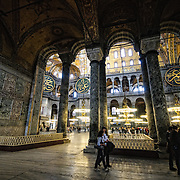 Arches and columns from the side of Hagia Sophia in Istanbul, Turkey. Originally built as a Christian cathedral, then converted to a Muslim mosque in the 15th century, and now a museum (since 1935), the Hagia Sophia is one of the oldest and grandest buildings in Istanbul. For a thousand years, it was the largest cathedral in the world and is regarded as the crowning achievement of Byzantine architecture.
