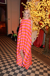 POPPY DELEVINGNE at the Sugarplum Dinner - The event was for the launch of Sugarplum Children, a new website and fundraising initiative for children who live with type 1 diabetes, and to raise money for JDRF (Juvenile Diabetes Research Foundation) held at One Mayfair, 13A North Audley Street, London on 20th November 2013.