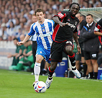 Photo: Chris Ratcliffe.<br />Colchester United v Queens Park Rangers. Coca Cola Championship. 16/09/2006.<br />Damion Stewart (R) of QPR clashes with Jamie Cureton of Colchester United.