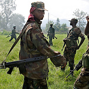 Soldiers from the rebel group CNDP outside a rally in support of recent CNDP victories against the Congolese army.