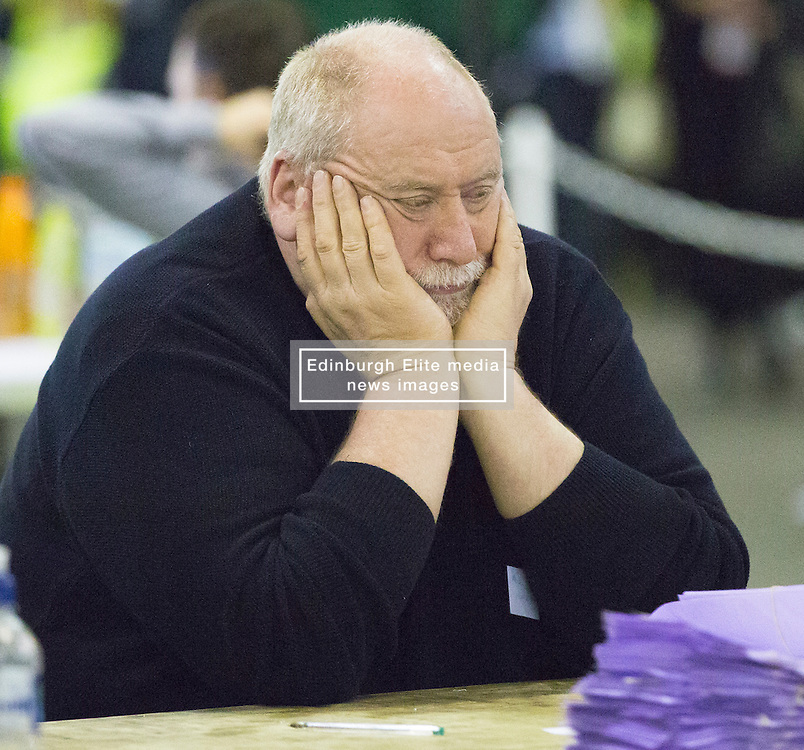 Scottish Parliament Election 2016 Royal Highland Centre Ingliston Edinburgh 05 May 2016; an exhausted counter shuts his eyes for a rest during the Scottish Parliament Election 2016, Royal Highland Centre, Ingliston Edinburgh.<br /> <br /> (c) Chris McCluskie   Edinburgh Elite media