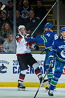 KELOWNA, BC - SEPTEMBER 29: Richard Panik #14 of the Arizona Coyotes is check by Erik Gudbranson #44 of the Vancouver Canucks during first period at Prospera Place on September 29, 2018 in Kelowna, Canada. (Photo by Marissa Baecker/NHLI via Getty Images)  *** Local Caption *** Erik Gudbranson; Richard Panik;