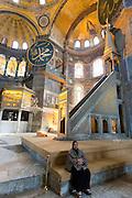 Muslim woman at Hagia Sophia, Ayasofya Muzesi, mosque museum  in Sultanahmet, Istanbul, Republic of Turkey