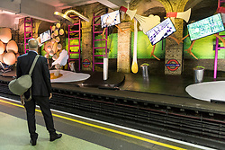 "© Licensed to London News Pictures. 07/06/2018. LONDON, UK.  A commuter views a new artwork ""my name is lettie eggyscrub"", by British artist Heather Phillipson, unveiled at Gloucester Road Underground station filling the 80m platform.  The installation is a major commission for Art on the Underground.  Photo credit: Stephen Chung/LNP"