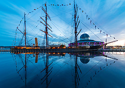 Reflection  of RRS Discovery ship at Discovery Point museum in the evening in Dundee, Tayside, Scotland, UK