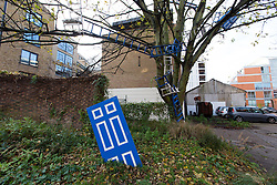 © Licensed to London News Pictures. 01/12/2013. London, UK. Image date: 23 November 2013. A long term art installation of weathered doors, chairs and ladders is seen in the grounds of the Wapping Project (formerly the Wapping Hydraulic Power Station). The Wapping Project restaurant and art space will close at the end of 2013. Photo credit : Vickie Flores/LNP