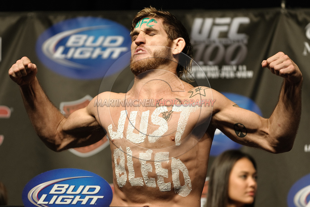LAS VEGAS, NEVADA, JULY 10, 2009: Tom Lawlor poses on the scales during the weigh-in for UFC 100 inside the Mandalay Bay Events Center in Las Vegas, Nevada