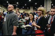 Kelly Sweeney, second from right, and others wait to have their books signed by Ann Coulter and during the final day of the Conservative Political Action Conference (CPAC) at the Gaylord National Resort & Convention Center in National Harbor, Md.