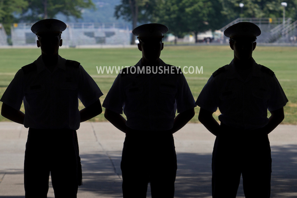 West Point, New York - Cadets in the red sash wait for new cadets to report during Reception Day at the United States Military Academy at West Point on July 2, 2014. About 1,200 cadet candidates, the West Point Class of 2018, reported to the academy to begin their military careers.