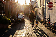 Een man fietst met een OV-fiets in de hand door Utrecht.<br /> <br /> A man cycles with another bike by hand in Utrecht.