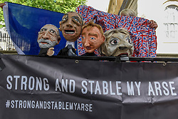 © Licensed to London News Pictures. 09/06/2017. London, UK. Puppets depicting (L to R) Jeremy Corbyn, Nigel Farage, Tim Farron and Theresa May are seen above a banner with wording that re-interprets the Tory manifesto slogan.  Anti-Tory protesters demonstrate outside Downing Street on the day that the General Election results produced a hung Parliament.  A variety of different groups, from LGBT supporters to Save the NHS supporters, gathered to make their views heard. Photo credit : Stephen Chung/LNP
