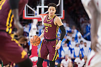 FAYETTEVILLE, AR - DECEMBER 9:  Amir Coffey #5 of the Minnesota Golden Gophers runs the offense during a game against the Arkansas Razorbacks at Bud Walton Arena on December 9, 2017 in Fayetteville, Arkansas.  The Razorbacks defeated the Golden Gophers 95-79.  (Photo by Wesley Hitt/Getty Images) *** Local Caption *** Amir Coffey