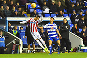 Sam Baldock (9) of Reading shoves Tom Ince (7) of Stoke City off the ball before Mo Barrow (17) of Reading scored the equalising goal seconds later during the EFL Sky Bet Championship match between Reading and Stoke City at the Madejski Stadium, Reading, England on 1 December 2018.