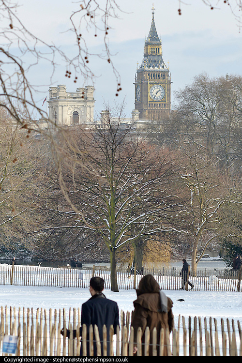 © Licensed to London News Pictures. 21/01/2013. Westminster, UK Big Ben seen in the distance through snow covered trees. Snow in the Royal Park, St James Park, in Central London today 21 January 2013. Photo credit : Stephen Simpson/LNP