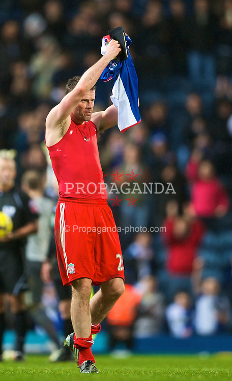 BLACKBURN, ENGLAND - Saturday, December 5, 2009: Liverpool's Jamie Carragher looks dejected as he applauds the travelling supporters, after his side's 0-0 draw against Blackburn Rovers, during the Premiership match at Ewood Park. (Photo by David Rawcliffe/Propaganda)