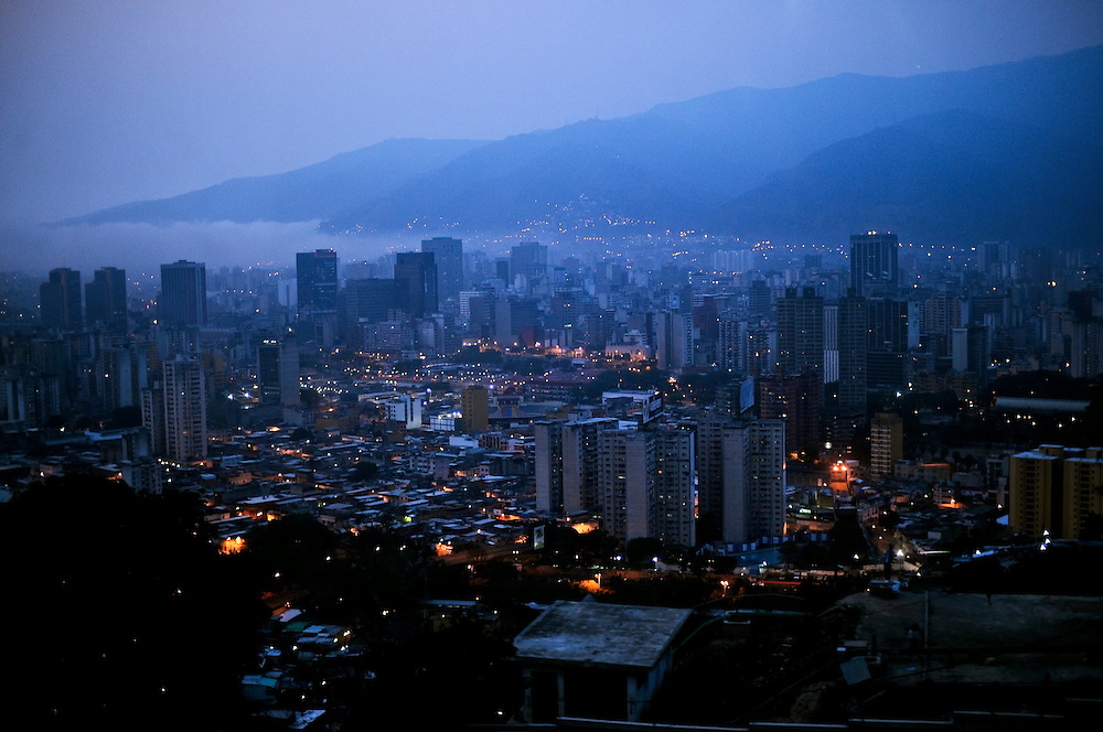 Caracas, Venezuela at dusk. The Venezuelan government commissions young graffiti artists to plaster the city in murals and stencils that promote the Bolivarian revolution and the political agenda of President Hugo Chavez.