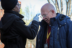 March 16, 2020, Washington, District of Columbia, USA: Staff from the White House Physician's Office screen for fever of people entering the White House with a forehead temperature scanner in Washington, DC.  (Credit Image: © Oliver Contreras/CNP via ZUMA Wire)