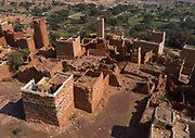 SAUDI ARABIA FROM ABOVE<br />  This village is located in the Asir province and features houses made of a unique mix of red mud and stone. Although the properties are now crumbling, there are still colorful drawings decorating the interior walls. The ground floor of these houses was intended for livestock. The first floor was for human accommodation and included small windows to keep out the heat as well as intruders. As you go up the building, the windows become larger to let more light in as well as cooler air.