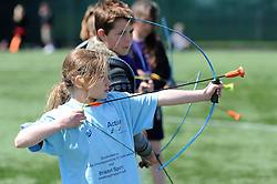 Children part take in archery during the Bristol Sport Youth Festival - Photo mandatory by-line: Dougie Allward/JMP - Mobile: 07966 386802 - 06/06/2015 - SPORT - Multi-Sport - Bristol - SGS Wise Campus - Bristol Sport Festival Of Youth Sport - Festival Of Youth