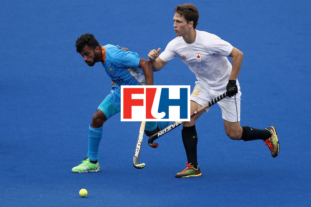 RIO DE JANEIRO, BRAZIL - AUGUST 12:  Chandanda Thimmaiah #32 of India runs past Taylor Curran #29 of Canada during a Men's Preliminary Pool B match on Day 7 of the Rio 2016 Olympic Games at the Olympic Hockey Centre on August 12, 2016 in Rio de Janeiro, Brazil.  (Photo by Sean M. Haffey/Getty Images)
