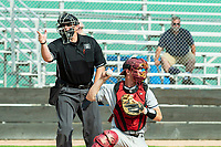 KELOWNA, BC - JULY 06:  The umpire calls a strike as catcher Caleb Farmer #15 of the Walla Walla Sweets returns the ball to the pitcher's mound against the Kelowna Falcons at Elks Stadium on July 6, 2019 in Kelowna, Canada. (Photo by Marissa Baecker/Shoot the Breeze)