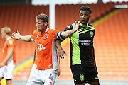 Bury midfielder Tom Soares (19)Blackpool midfielder Jim McAlister (4) and  during the Pre-Season Friendly match between Blackpool and Bury at Bloomfield Road, Blackpool, England on 30 July 2016. Photo by Simon Davies.