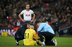 Tottenham Hotspur's Harry Kane after a challenge with Manchester City goalkeeper Ederson during the Premier League match at Wembley Stadium, London.