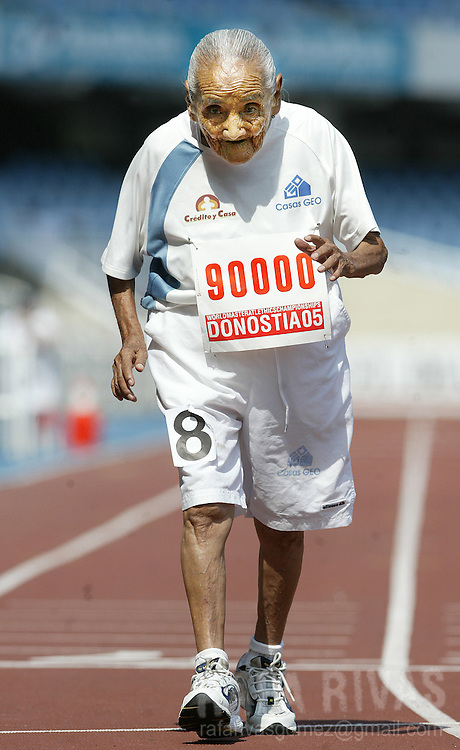 """Mexican athlete Rosario Iglesias """"Chayito"""", 95, crosses the finish line after running her 200 m  race in 1:59.45 min, 29 August 2005 during the celebration of the XVI WMA World Master Athletics Championships Stadia 2005, in the northern Spanish Basque town of San Sebastian."""
