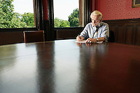 Man Writing in Conference Room