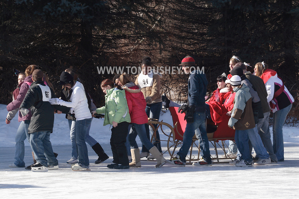 Livingston Manor, NY  - A group of teenagers give the sleight carrying the festival King and Queen around the ice at the 49th annual Livingston Manor Rotary Ice Carnival on Jan. 27, 2008.