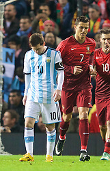 MANCHESTER, ENGLAND - Tuesday, November 18, 2014: Argentina's captain Lionel Messi and Portugal's captain Cristiano Ronaldo during the International Friendly match at Old Trafford. (Pic by David Rawcliffe/Propaganda)
