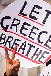 London, February 15th 2015. Londoners demonstrate in solidarity with Greeks in their fight against the EU's insistance that they maintain their programme of austerity. PICTURED: A placard displays the rallying cry of Greeks against the restrictive nature of the austerity programme imposed by the EU.