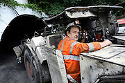 A miner is entering the Aberpergwm mine driving an automotive machinery needed underground, on Tuesday, June 19, 2007, in Cwmgwrach, Vale of Neath, South Wales. The time is ripe again for an unexpected revival of the coal industry in the Vale of Neath due to the increasing prize and diminishing reserves of oil and gas, the uncertainties of renewable energy sources, and the technological advancement in producing energy from coal while limiting emissions of pollutants, has created the basis for valuable investment opportunities and a possible alternative to the latest energy crisis. Unity Mine, in particular, has started a pioneering effort to revive the coal industry in the area, reopening after more than 8 years with the intent of exploiting the large resources still buried underground. Coal could be then answer to both, access to cheaper and paradoxically greener energy and a better and safer choice than nuclear energy as a major supply for the decades to come. It is estimated that coal reserves in Wales amount to over 250 million tonnes, or the equivalent of at least 50 years of energy supply, while the worldwide total coal could last for over 200 years as a viable resource compared to only a few decades of oil and natural gas.