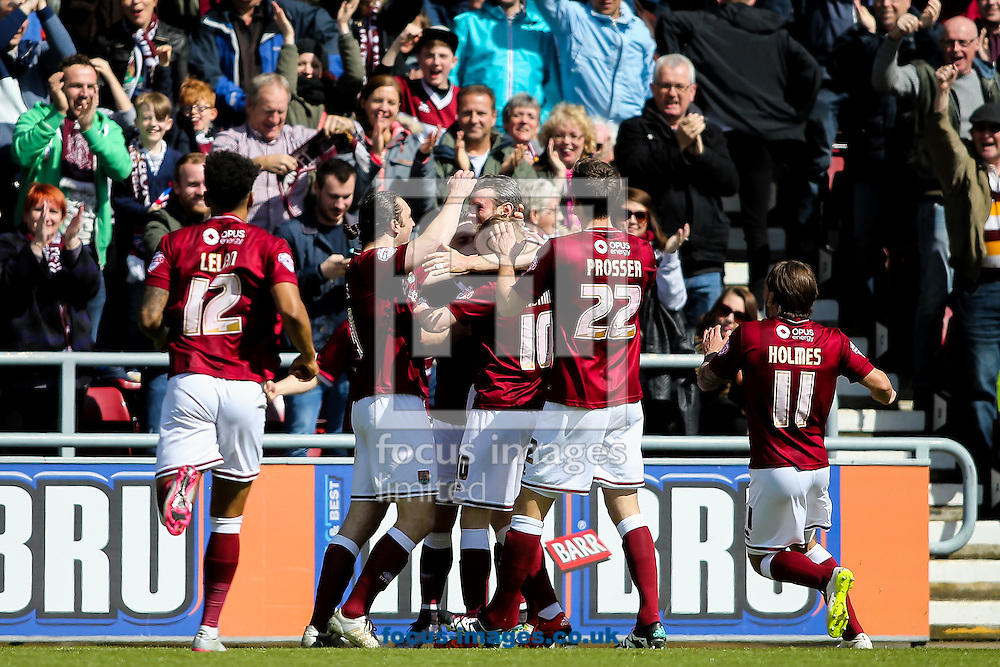 Zander Diamond of Northampton Town (centre) celebrates  scoring their first goal during the Sky Bet League 2 match at Sixfields Stadium, Northampton<br /> Picture by Andy Kearns/Focus Images Ltd 0781 864 4264<br /> 30/04/2016