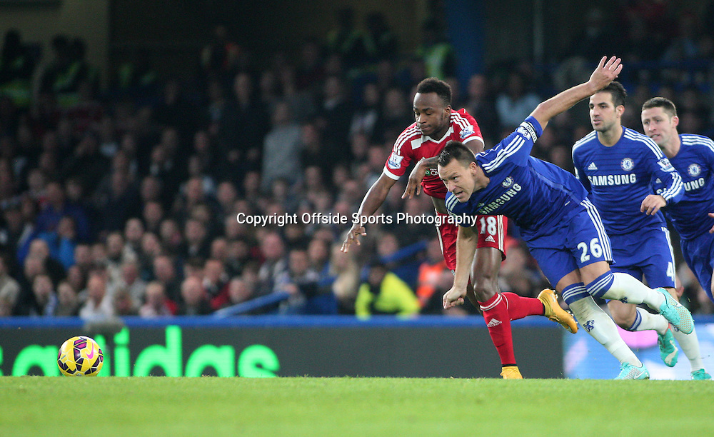 22 November 2014 - Barclays Premier League - Chelsea v West Bromwich Albion - Saido Berahino of Albion fouls John Terry of Chelsea.<br /> <br /> <br /> Photo: Ryan Smyth/Offside
