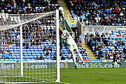 Luke Daniels (28) of Brentford tips the ball over the bar after nearly being caught out by a free kick during the EFL Sky Bet Championship match between Reading and Brentford at the Madejski Stadium, Reading, England on 13 April 2019.