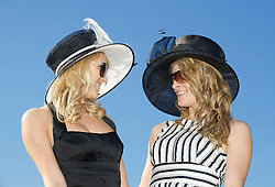 LIVERPOOL, ENGLAND, Friday, April 8, 2011: Madaline and Mandy from Norway during Ladies' Day on Day Two of the Aintree Grand National Festival at Aintree Racecourse. (Photo by David Rawcliffe/Propaganda)