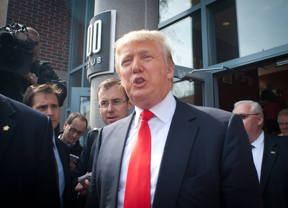 Donald trump emerges from the 100 Club from meetings as he made his way around Portsmouth, NH. Real Estate Mogul, TV Star and Presidential hopeful Donald Trump makes a visit to Portsmouth, NH for meetings and a meet and greet as he walks around Downtown Portsmouth.