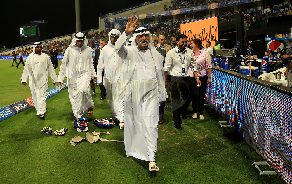 His Excellency Shaikh Nahayan Mubarak greats the fan's  as he takes a lap during match 19 of the Pepsi Indian Premier League 2014 Season between The Kolkata Knight Riders and the Rajasthan Royals held at the Sheikh Zayed Stadium, Abu Dhabi, United Arab Emirates on the 29th April 2014<br /> <br /> Photo by Sandeep Shetty / IPL / SPORTZPICS