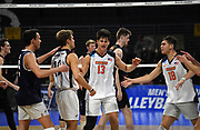Pepperdine Waves middle blocker Max Chamerlain (13) celebrates with teammates Noah Dyer (5), Kaleb Denmark (10) and Robert Mullahey (18) against the Princeton Tigers  during an NCAA Championships opening round match, Wednesday, April 30, 2019, in Long Beach, Calif. Pepperdine defeated Princeton 25-23, 19-25, 25-16, 22-25, 15-8.
