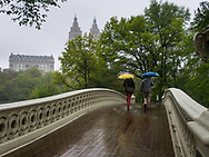 Bow Bridge in Central Park with a view of the San Remo apartment towers.