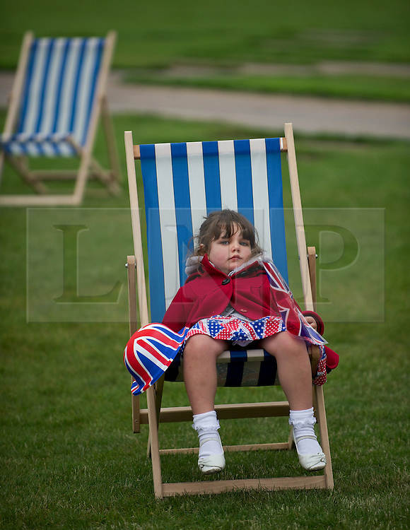 © Licensed to London News Pictures. 03/06/12.Middlesbrough, England...Kallisata Lakin aged 4, from Australia takes a moment to relax during a party to celebrate the Queen's Diamond Jubilee in Middlesbrough town centre.. .The Royal Jubilee celebrations. Great Britain is celebrating the 60th  anniversary of the countries Monarch HRH Queen Elizabeth II accession to the throne this weekend Photo credit : Ian Forsyth/LNP
