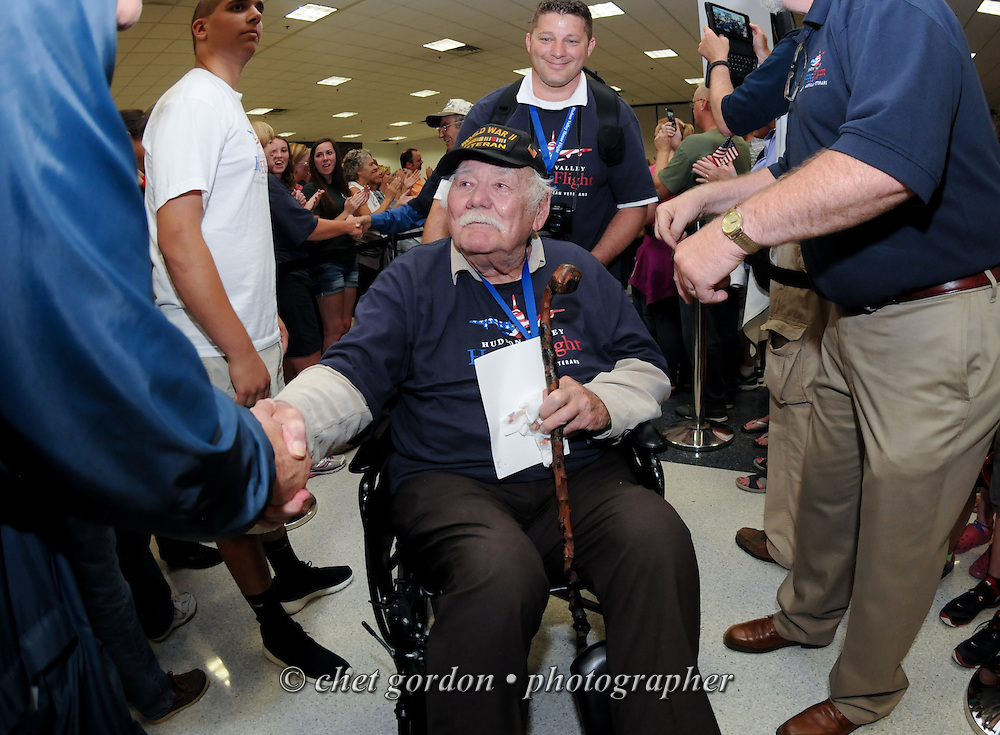 WWII Veterans and their escorts arrive at Stewart International Airport in Newburgh, NY during their Hudson Valley Honor Flight to Washington, DC on Saturday, September 27, 2014. Nearly one hundred WWII Veterans from the Hudson Valley region of New York toured the WWII Memorial in Washington, DC and Arlington National Cemetery in Arlington, VA.  © www.chetgordon.com
