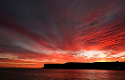 © Licensed to London News Pictures.17/11/15<br /> Saltburn, UK. <br /> <br /> A spectacular sunrise lights up clouds over cliffs on the east coast of England near Saltburn in Cleveland.<br /> <br /> Photo credit : Ian Forsyth/LNP