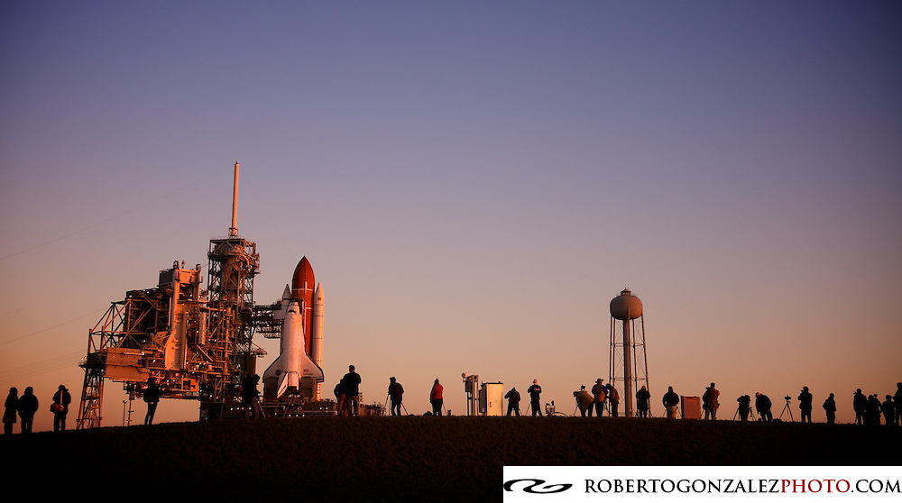 CAPE CANAVERAL, FL - MARCH 11:  Sunrise as photographers gather on a hill to take pictures shortly after Space shuttle Endeavor arrived at Launch Pad 39A, Endeavour's liftoff is planned for April 19. The mission commander is Mark Kelly, the husband of U.S. Rep. Gabrielle Giffords of Arizona. (Photo by Roberto Gonzalez/Getty Images)